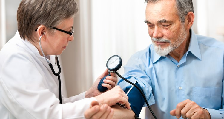 Healthcare provider measuring blood pressure.