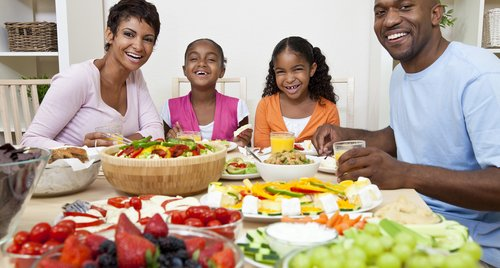 Family eating salad and healthy food.